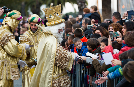 melchor: BARCELONA, SPAIN â JANUARY 5, 2017: Three of King with entourage take letters from children. Barcelona, ??Spain Editorial