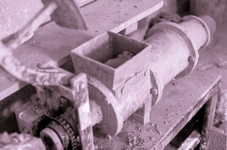 Closeup view on clay forming machine in working process in pottery workshop Stock Photo