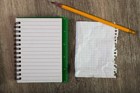 not open: Torn sheets with notebooks and writing utensils