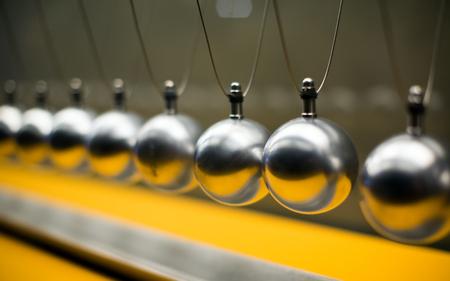 Cartesian impulse conservation law experiment metallic balls