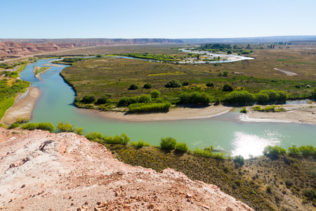 indios: View on river and green plants of valley from hill near Paso de Indios in Patagonia area Stock Photo