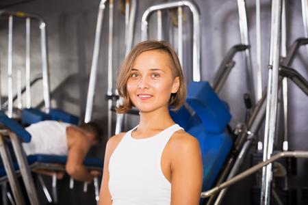 Portrait of woman taking pause between exercising in gym indoors Reklamní fotografie