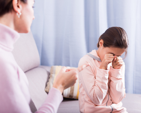 Mother reprimands her daughter for wrong things and bad behavior