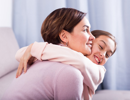 Daughter asks for forgiveness and be reconciled with his young mother after quarrel Stock Photo