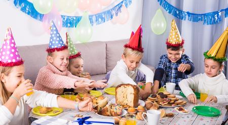 animation teenagers: Emotional children having dinner to celebrate friend's birthday