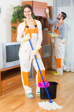 cleaning service: Professional cleaners cleaning at home