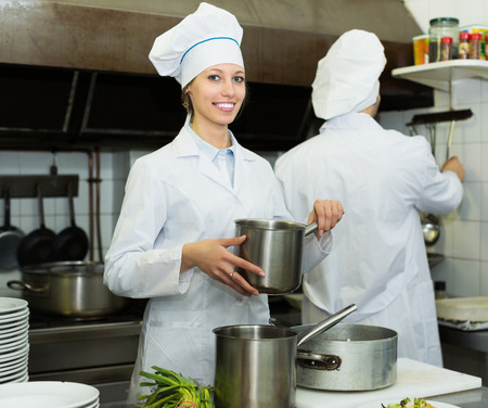 shef: Head-cooks cooking at professional kitchen in the restaurant Stock Photo
