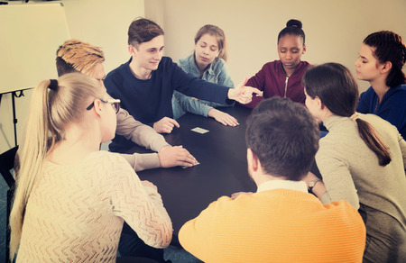 animation teenagers: Happy young male and female students playing Mafia game at recess