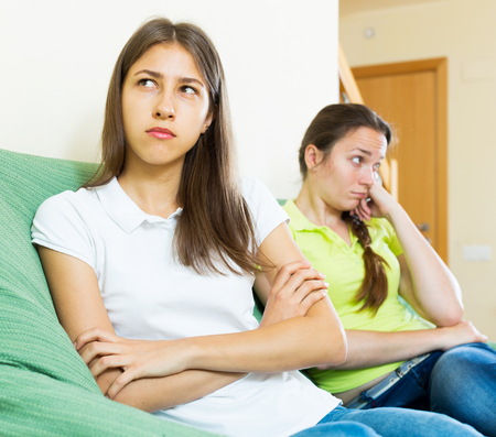 Sad adult women looking away after conflict at home