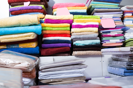 mass storage: The picture of loop towels in  textile shop indoors Stock Photo