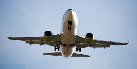 BARCELONA, SPAIN - MARCH 09, 2017:  Air Baltic plane landing in El Prat Airport on time. Barcelona, Spain