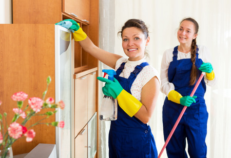 Positive young female workers cleaning company ready to start work