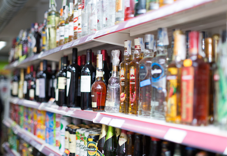 soft sell: BARCELONA, SPAIN - MARCH 22, 2015: Shelves with wine, beer and soft drinks at beverage section of average Polish supermarket Editorial
