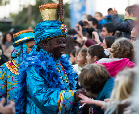 BARCELONA, SPAIN –  JANUARY 5, 2017: King Baltasar with suite takes from children of letter. Barcelona, Catalonia