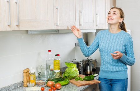 Smiling girl learning new recipe of vegetables at home Stock Photo