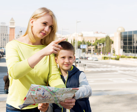 journeying: Mother and son consulting map guide during sightseeing tour