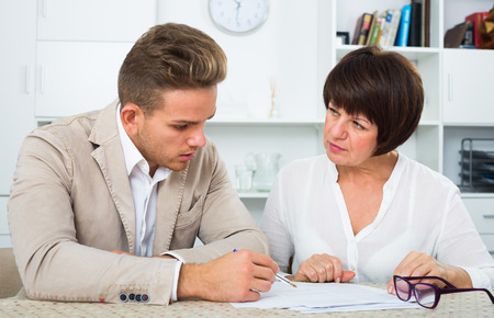 Man consults at the familiar positive lawyer concerning paperwork