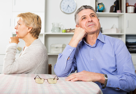 indignant: Mature couple quarrels with each other at clarification of the family relation in home Stock Photo