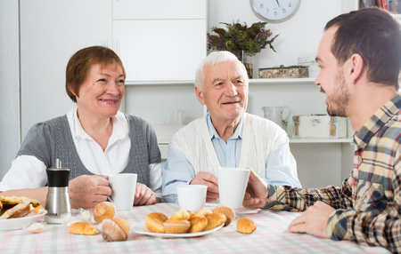 Elderly couple and social department employee complete questionnaire Stock Photo