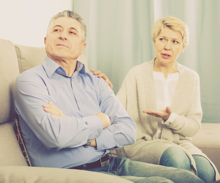 upset mature couple quarreling at home with each other and take offense Stock Photo