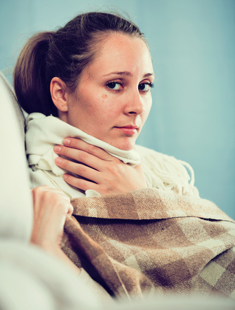 Young girl with cold trying to get well at home