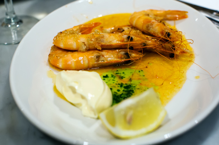 Nicely served prawns with lemon and souse in cafe Stock Photo