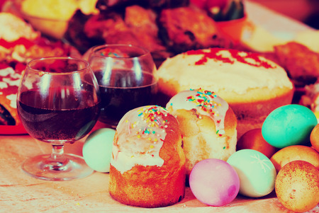 Easter cakes and other meal on festive table