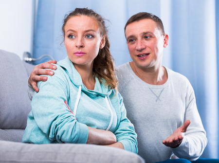 Husband and wife having disagreement with each other at home Фото со стока