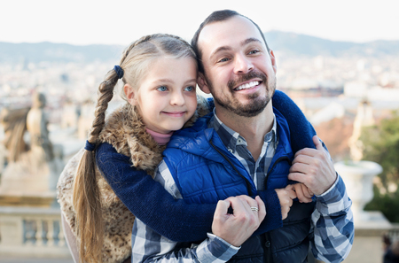 journeying: Smiling man and daughter exploring city during sightseeing tour Stock Photo