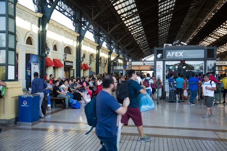departing: SANTIAGO, CHILE – FEBRUARY 10, 2017:  Central Railway Station full of waiting people. Santiago, Chile