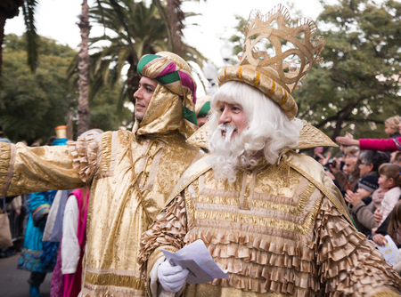 BARCELONA, SPAIN –  JANUARY 5, 2017: Three of King with entourage take letters from children. Barcelona, Spain