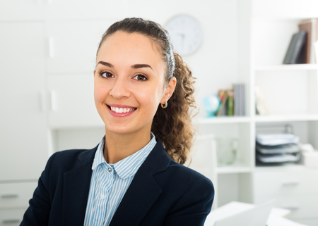 Successful and confident smiling woman working in modern office