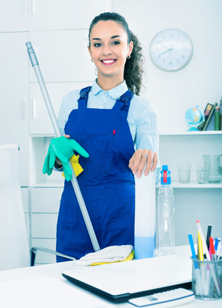 Portrait of girl in overall doing professional clean-up