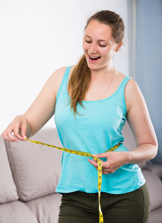Young woman achieving success with weight loss at home