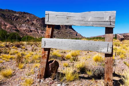 Wooden signboard in the wild west area