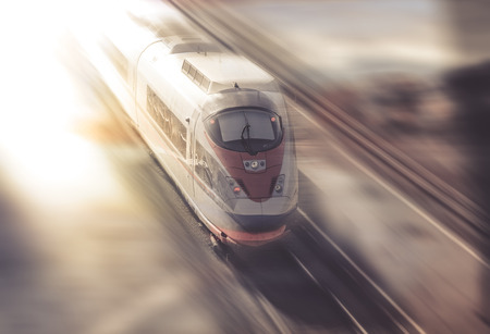 Train traveling with great speed through new places