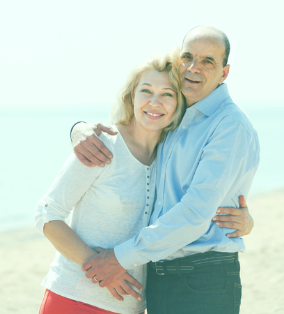 Portrait of mature couple against sea in background Stock Photo