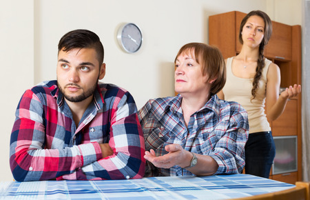 squabble: Mature mother having conflict with their unhappy children Stock Photo