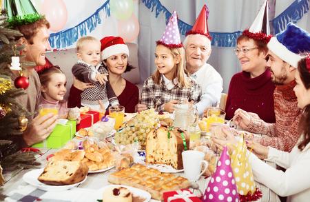 Positive family members having celebration of children's birthday during dinner