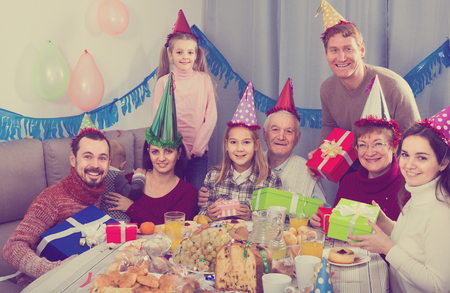 Large smiling family having fun during children's birthday party