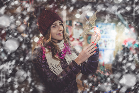 festal: Glad young girl choosing xmas gifts at  festive Stock Photo