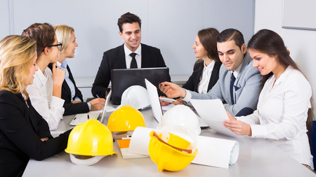 Office brainstorming of professional business team at meeting in interior Stock Photo