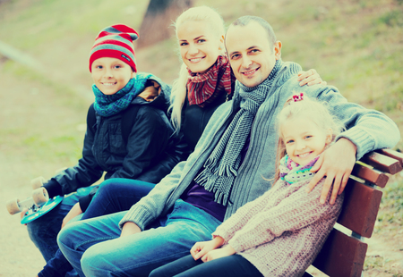 russian spouses with children posing in autumn park and smiling Stock Photo