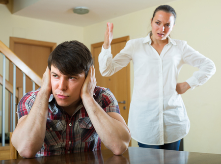 variance: Unhappy guy and sad woman during conflict at home