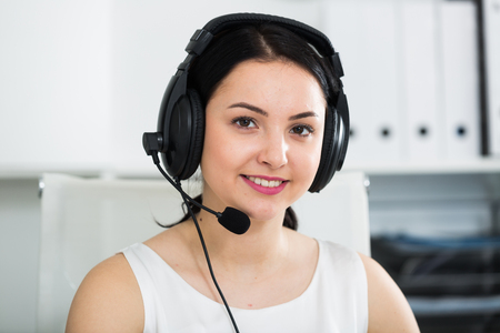expertize: Smiling female worker working effectively at call-center