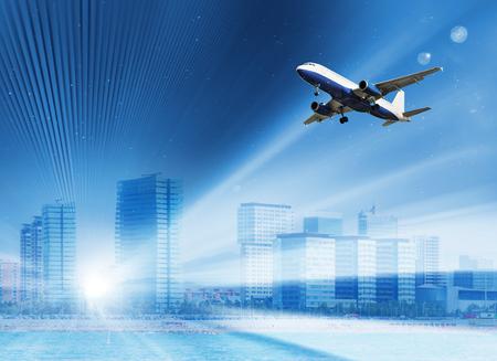 飛行機で急速に雲の中の建物 写真素材