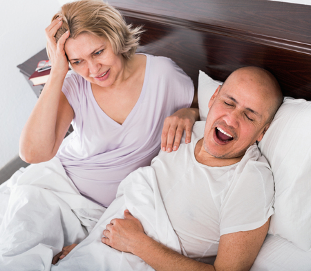 Mature exhausted woman disturbed with partner snores continiously
