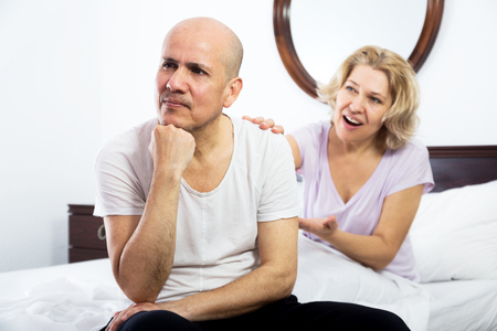 scandals: Mature family couple getting through scandals and blamings in bedroom