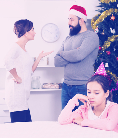 Father and mother having disagreement during Christmas at home