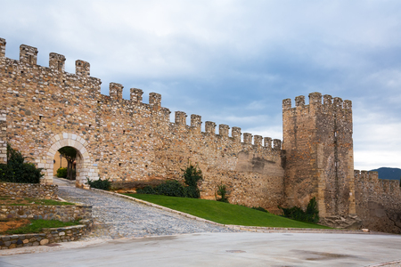 Picturesque ancient Monblanc city walls at cloudy day in Catalonia Editorial